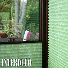 Grünes Plissee für einen frischen Sichtschutz.